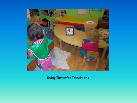 Using Timer for Transitions [photograph: timer on table and toddlers]