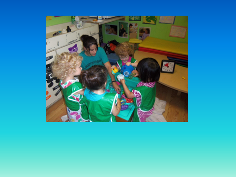 [photograph: toddlers in classroom]
