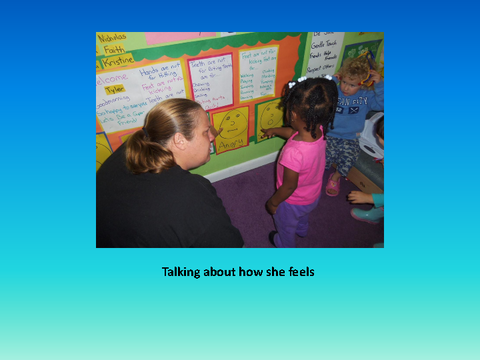Talking about how she feels [photograph: teacher and toddler]