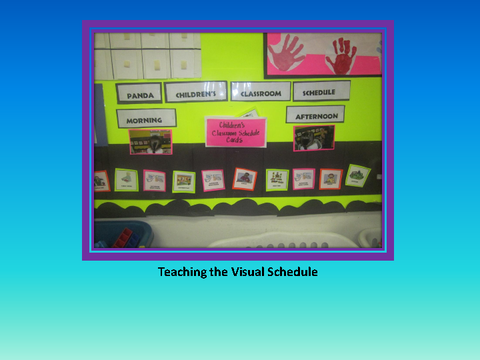 Teaching the Visual Schedule [photograph: wall newspaper]