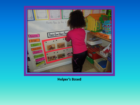 Helper's Board [photograph: child in front of wall newspaper]