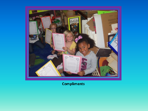 Compliments [photograph: children in class room]