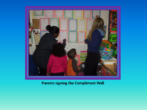 Parents signing the Compliment Wall