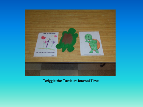 Twiggle the Turtle at Journal Time [photograph: toys on table]