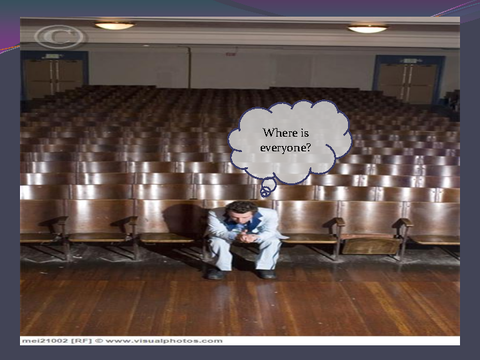 Where is everyone? [photograph: teacher in auditorium]