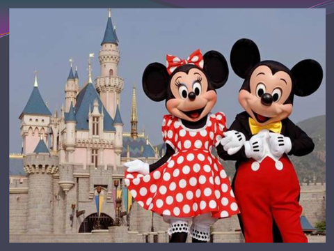 [photograph: Mickey Mouse and Minnie Mouse, castle]